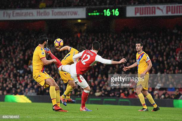 Olivier Giroud of Arsenal scores the opening goal during the Premier League match between Arsenal and Crystal Palace at Emirates Stadium on January...