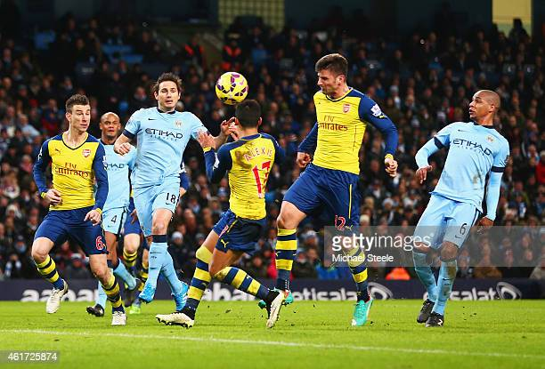 Olivier Giroud of Arsenal scores their second goal during the Barclays Premier League match between Manchester City and Arsenal at Etihad Stadium on...