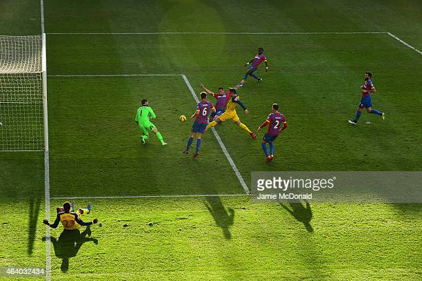 Olivier Giroud of Arsenal scores their second goal past goalkeeper Julian Speroni of Crystal Palace during the Barclays Premier League match between...