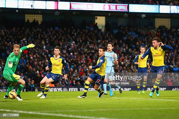 Olivier Giroud of Arsenal scores their second goal with a header past goalkeeper Joe Hart of Manchester City during the Barclays Premier League match...