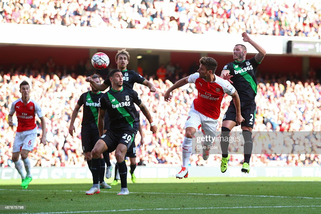 Olivier Giroud of Arsenal scores with a header during the Barclays Premier League match between Arsenal and Stoke City at the Emirates Stadium on September 12, 2015 in London, United Kingdom.