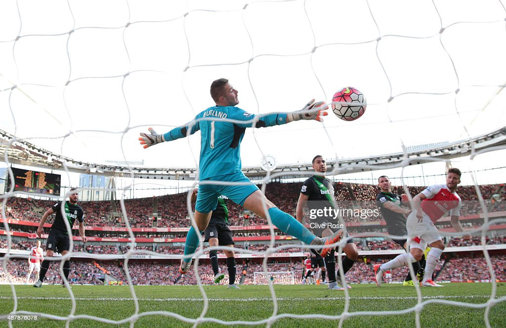 Olivier Giroud of Arsenal scores with a header past Jack Butland of Stoke City during the Barclays Premier League match between Arsenal and Stoke City at the Emirates Stadium on September 12, 2015 in London, United Kingdom.