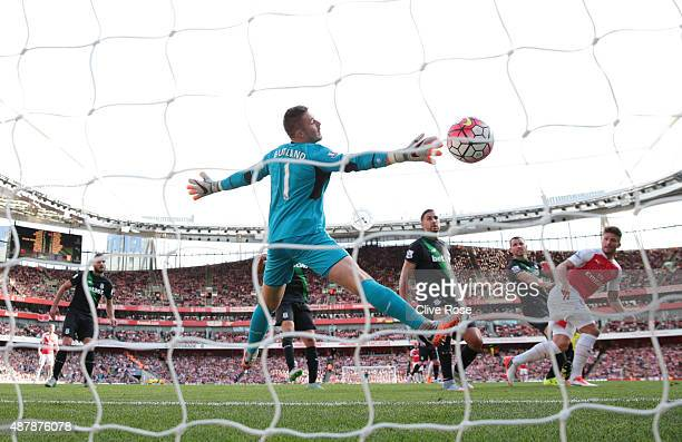 Olivier Giroud of Arsenal scores with a header past Jack Butland of Stoke City during the Barclays Premier League match between Arsenal and Stoke...