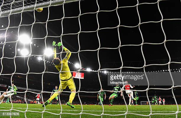 Olivier Giroud of Arsenal sees his shot saved by Lukasz Fabianski of Swansea City during the Barclays Premier League match between Arsenal and...