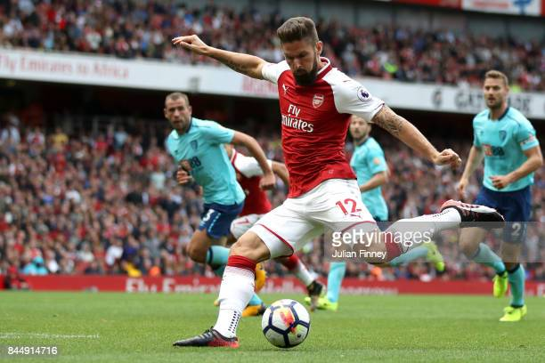Olivier Giroud of Arsenal shoots during the Premier League match between Arsenal and AFC Bournemouth at Emirates Stadium on September 9 2017 in...