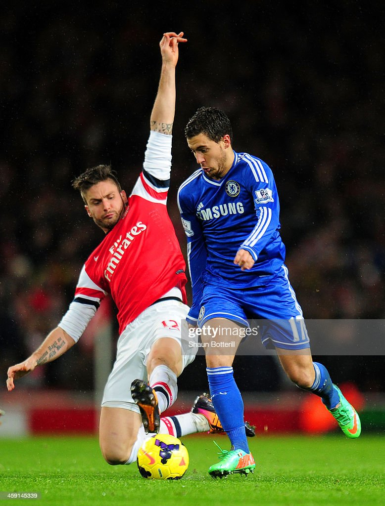 Olivier Giroud of Arsenal tackles Eden Hazard of Chelsea during the Barclays Premier League match between Arsenal and Chelsea at Emirates Stadium on December 23, 2013 in London, England.