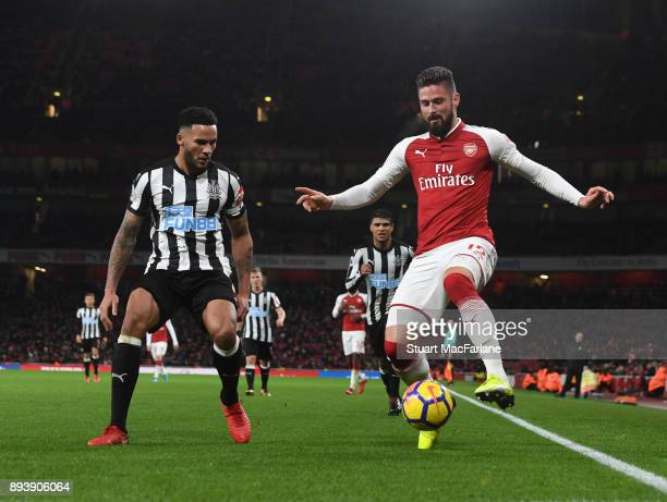 Olivier Giroud of Arsenal takes on Jamaal Lascelles of Newcastle during the Premier League match between Arsenal and Newcastle United at Emirates...