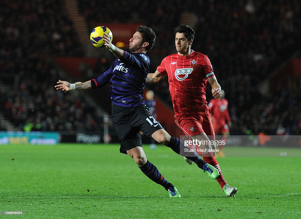 Olivier Giroud of Arsenal takes on Jose Fonte of Southampton during the Barclays Premier League match between Southampton and Arsenal at St Mary's Stadium on January 01, 2013 in Southampton, England.
