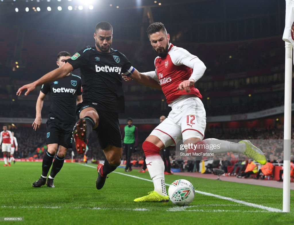 Olivier Giroud of Arsenal takes on Winston Reid of West Ham during the Carabao Cup Quarter Final match between Arsenal and West Ham United at Emirates Stadium on December 19, 2017 in London, England.