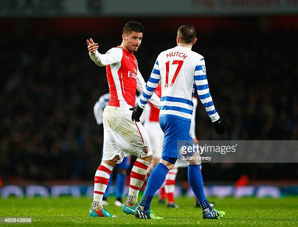 Olivier Giroud of Arsenal talks to Jordon Mutch of QPR after being sent off for a head butt on Nedum Onuoha of QPR during the Barclays Premier League...