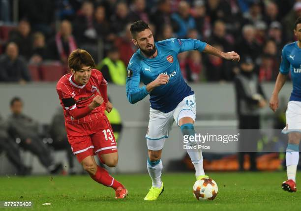 Olivier Giroud of Arsenal under pressure Yuya Osako of Cologne during the UEFA Europa League group H match between 1 FC Koeln and Arsenal FC at...