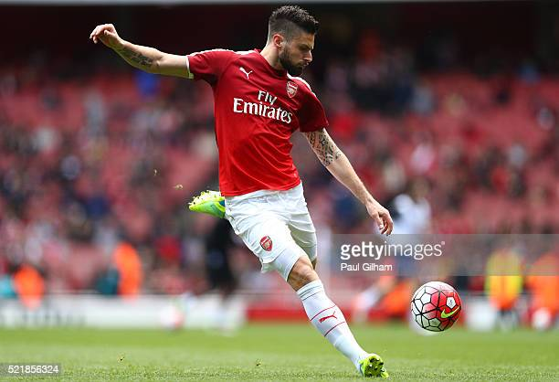 Olivier Giroud of Arsenal warms up ahead of the Barclays Premier League match between Arsenal and Crystal Palace at the Emirates Stadium on April 17...