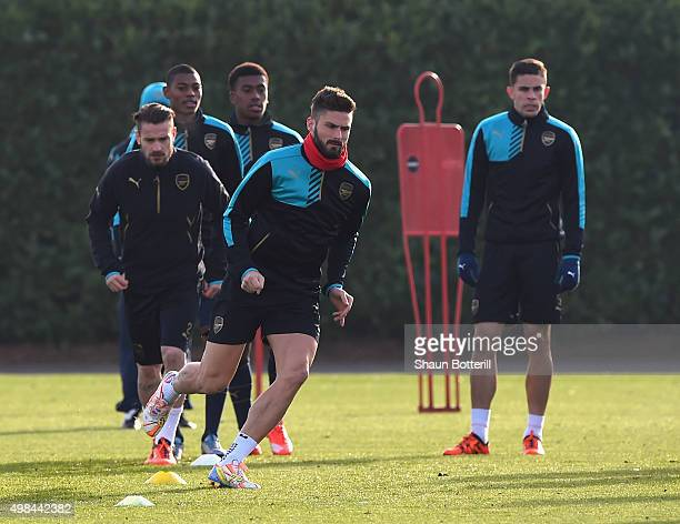 Olivier Giroud of Arsenal warmsup during a training session at London Colney on November 23 2015 in St Albans United Kingdom