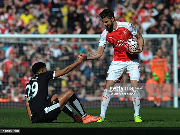 Olivier Giroud of Arsenal with Watford's Etienne Capoue during the Emirates FA Cup Sixth Round match between Arsenal and Watford at Emirates Stadium...