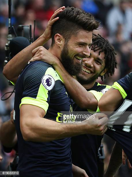Olivier Giroud of Arsenalis congratulated on scoring his second goal during the Premier League match between Sunderland and Arsenal at Stadium of...