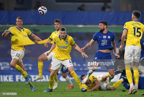 Olivier Giroud of Chelsea and Adam Webster of Brighton & Hove Albion battle for the ball during the Premier League match between Chelsea and Brighton...