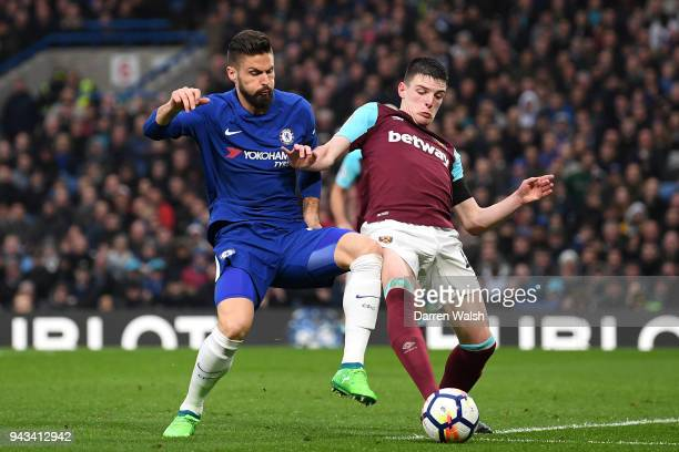 Olivier Giroud of Chelsea and Declan Rice of West Ham United battle for possession during the Premier League match between Chelsea and West Ham...
