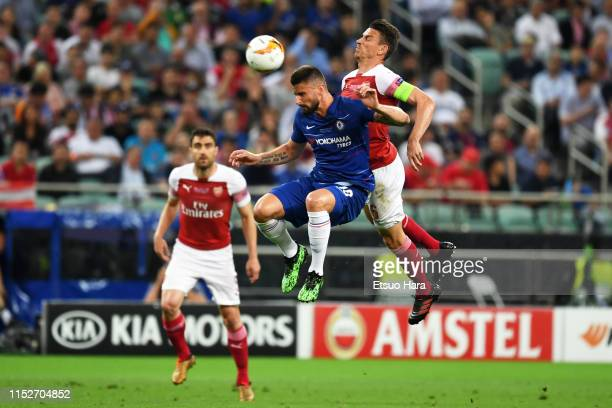Olivier Giroud of Chelsea and Laurent Koscielny of Arsenal compete for the ball during the UEFA Europa League Final between Chelsea and Arsenal at...