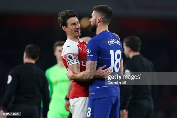 Olivier Giroud of Chelsea and Laurent Koscielny of Arsenal embrace after the Premier League match between Arsenal FC and Chelsea FC at Emirates...