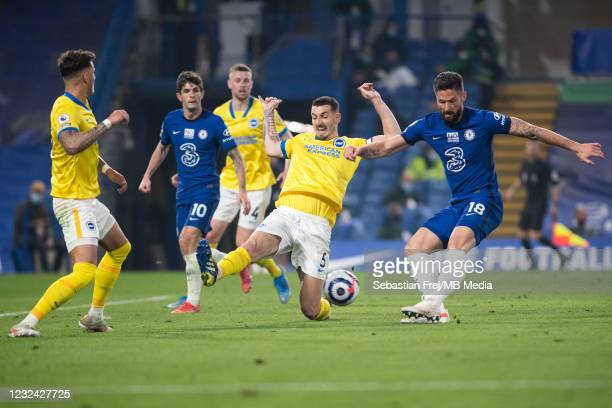 Olivier Giroud of Chelsea and Lewis Dunk of Brighton & Hove Albion in action during the Premier League match between Chelsea and Brighton & Hove...