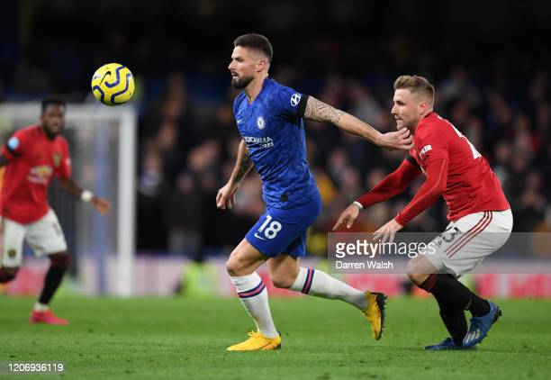 Olivier Giroud of Chelsea and Luke Shaw of Manchester United during the Premier League match between Chelsea FC and Manchester United at Stamford...