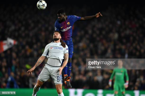 Olivier Giroud of Chelsea and Samuel Umtiti of Barcelona compete for the ball during the UEFA Champions League Round of 16 Second Leg match FC...
