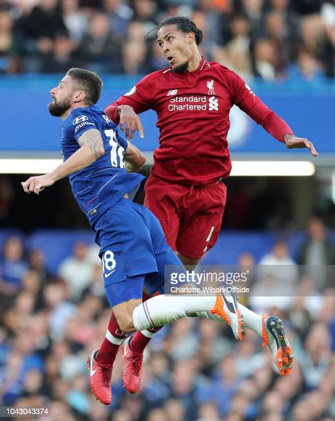 Olivier Giroud of Chelsea and Virgil van Dijk of Liverpool go up for a header during the Premier League match between Chelsea FC and Liverpool FC at...