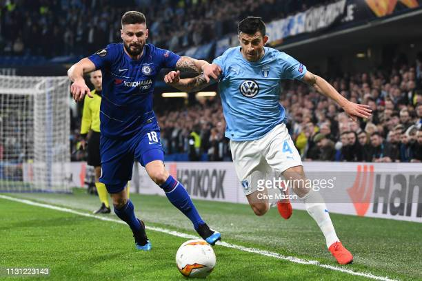 Olivier Giroud of Chelsea battles for possession with Behrang Safari of Malmo during the UEFA Europa League Round of 32 Second Leg match between...