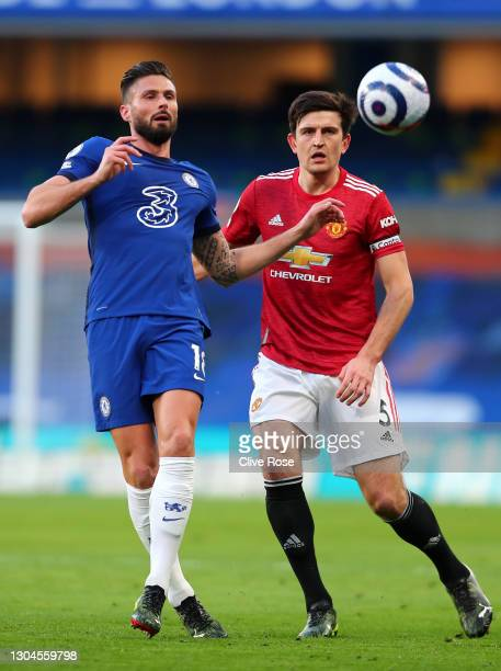 Olivier Giroud of Chelsea battles for possession with Harry Maguire of Manchester United during the Premier League match between Chelsea and...