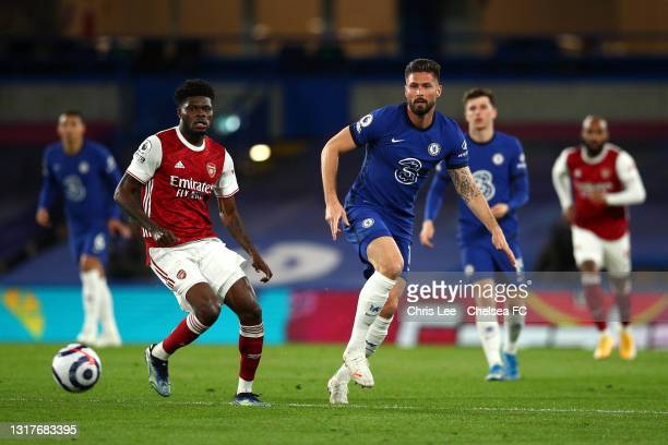 Olivier Giroud of Chelsea battles for possession with Thomas Partey of Arsenal during the Premier League match between Chelsea and Arsenal at...