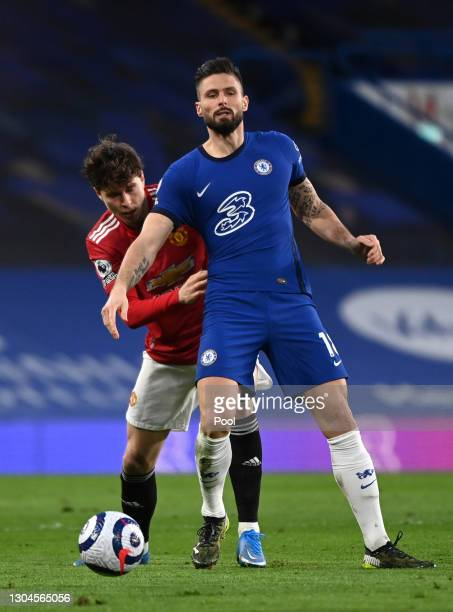 Olivier Giroud of Chelsea battles for possession with Victor Lindelof of Manchester United during the Premier League match between Chelsea and...