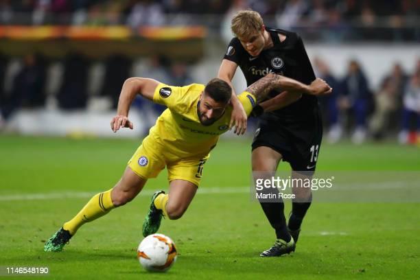 Olivier Giroud of Chelsea battles with Martin Hinteregger of Eintracht Frankfurt during the UEFA Europa League Semi Final First Leg match between...