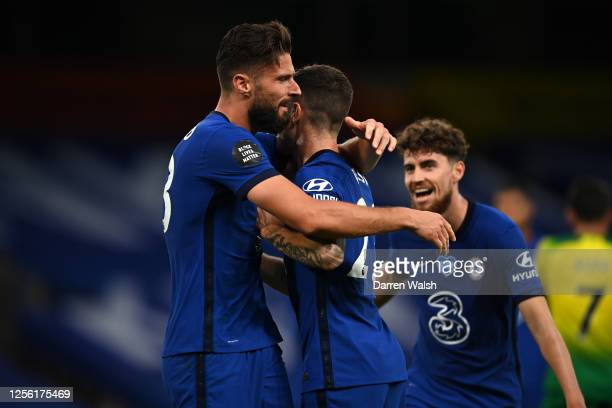 Olivier Giroud of Chelsea celebrates after scoring his sides first goal with Christian Pulisic during the Premier League match between Chelsea FC and...