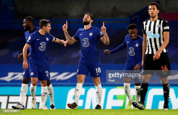 Olivier Giroud of Chelsea celebrates after scoring his sides first goal with Cesar Azpilicueta of Chelsea during the Premier League match between...