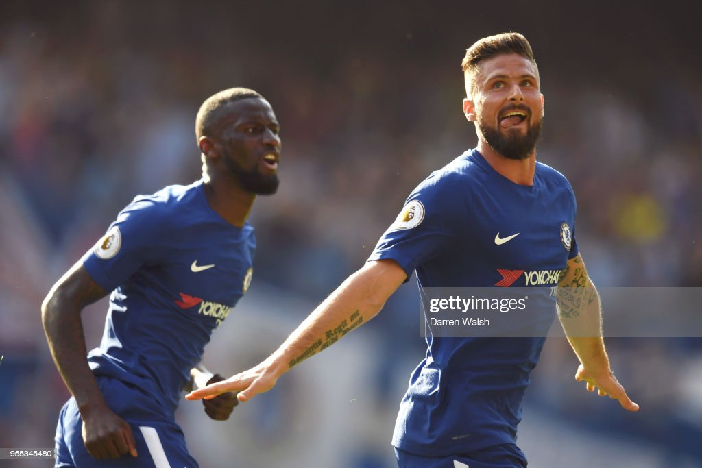 Olivier Giroud of Chelsea celebrates after scoring his sides first goal during the Premier League match between Chelsea and Liverpool at Stamford Bridge on May 6, 2018 in London, England.