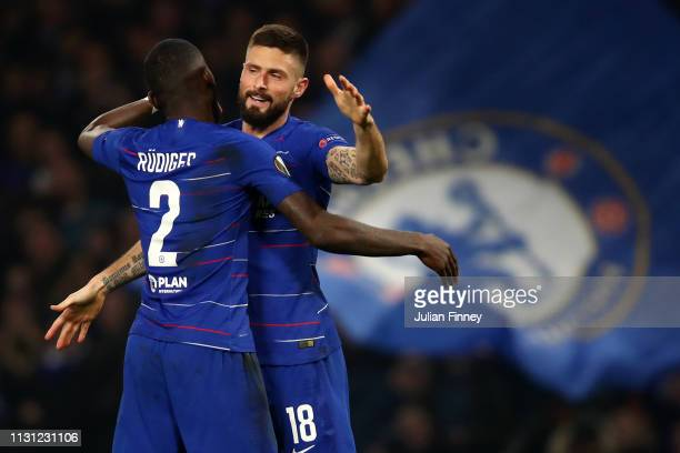 Olivier Giroud of Chelsea celebrates after scoring his team's first goal with Antonio Ruediger of Chelsea during the UEFA Europa League Round of 32...