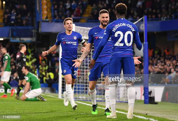 Olivier Giroud of Chelsea celebrates after scoring his team's first goal with Callum HudsonOdoi of Chelsea during the Premier League match between...