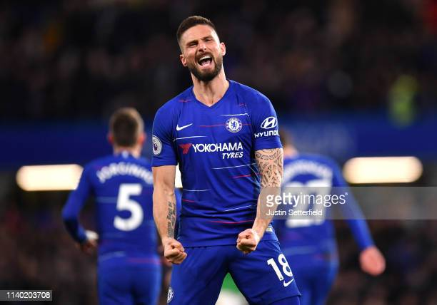 Olivier Giroud of Chelsea celebrates after scoring his team's first goal during the Premier League match between Chelsea FC and Brighton Hove Albion...