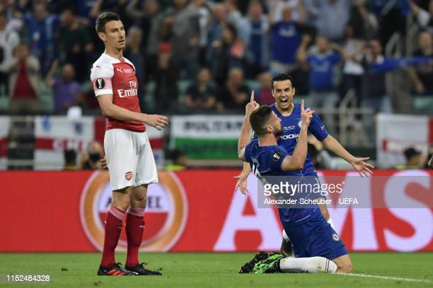 Olivier Giroud of Chelsea celebrates after scoring his team's first goal as Laurent Koscielny of Arsenal reacts during the UEFA Europa League Final...