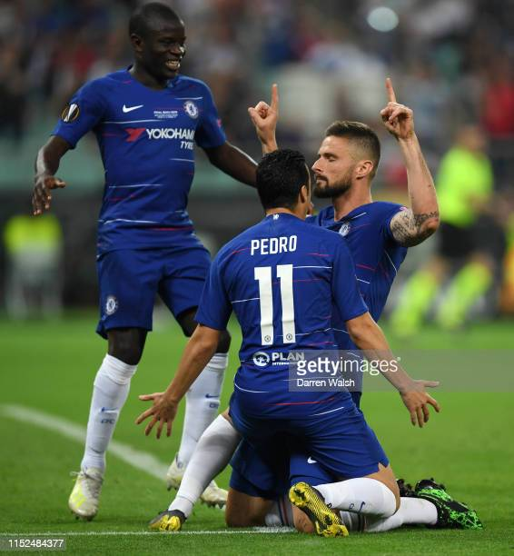 Olivier Giroud of Chelsea celebrates after scoring his team's first goal with Pedro of Chelsea and N'golo Kante during the UEFA Europa League Final...
