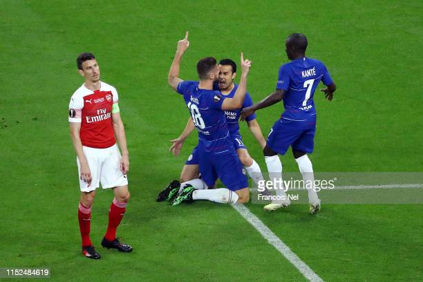 Olivier Giroud of Chelsea celebrates after scoring his team's first goal with Pedro and N'Golo Kante of Chelsea as Laurent Koscielny of Arsenal...