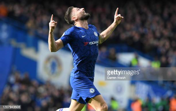 Olivier Giroud of Chelsea celebrates after scoring his team's first goal during the Premier League match between Chelsea FC and Tottenham Hotspur at...