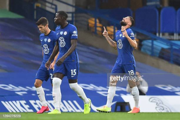 Olivier Giroud of Chelsea celebrates after scoring his team's first goal during the Premier League match between Chelsea FC and Watford FC at...