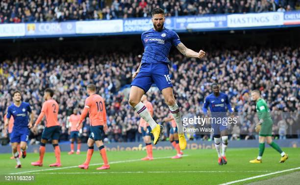 Olivier Giroud of Chelsea celebrates after scoring his team's fourth goal during the Premier League match between Chelsea FC and Everton FC at...