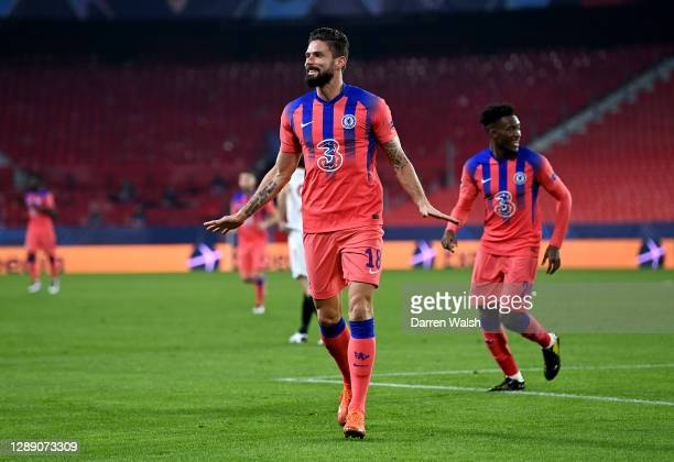 Olivier Giroud of Chelsea celebrates after scoring their sides first goal during the UEFA Champions League Group E stage match between FC Sevilla and...