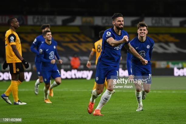 Olivier Giroud of Chelsea celebrates after scoring their sides first goal during the Premier League match between Wolverhampton Wanderers and Chelsea...
