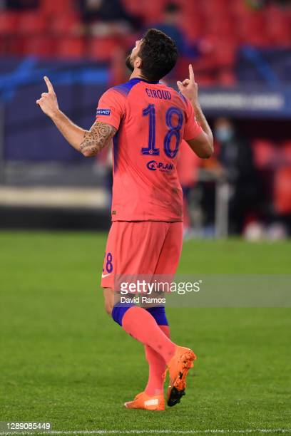 Olivier Giroud of Chelsea celebrates after scoring their sides fourth goal during the UEFA Champions League Group E stage match between FC Sevilla...