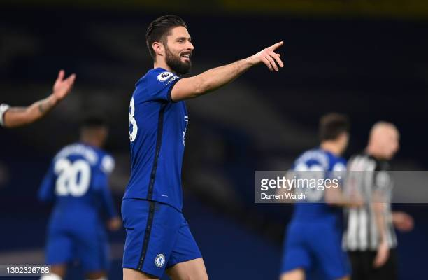 Olivier Giroud of Chelsea celebrates after scoring their team's first goal during the Premier League match between Chelsea and Newcastle United at...