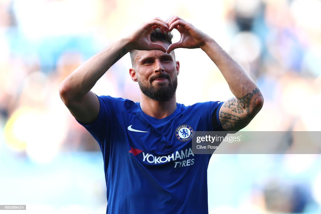 Olivier Giroud of Chelsea celebrates at the full time whistle after the Premier League match between Chelsea and Liverpool at Stamford Bridge on May 6, 2018 in London, England.