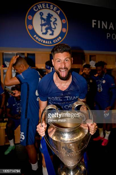 Olivier Giroud of Chelsea celebrates in the dressing room with the Champions League Trophy following their team's victory during the UEFA Champions...